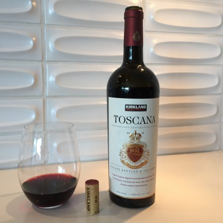 Bottle and glass of Kirkland Signature Toscana.