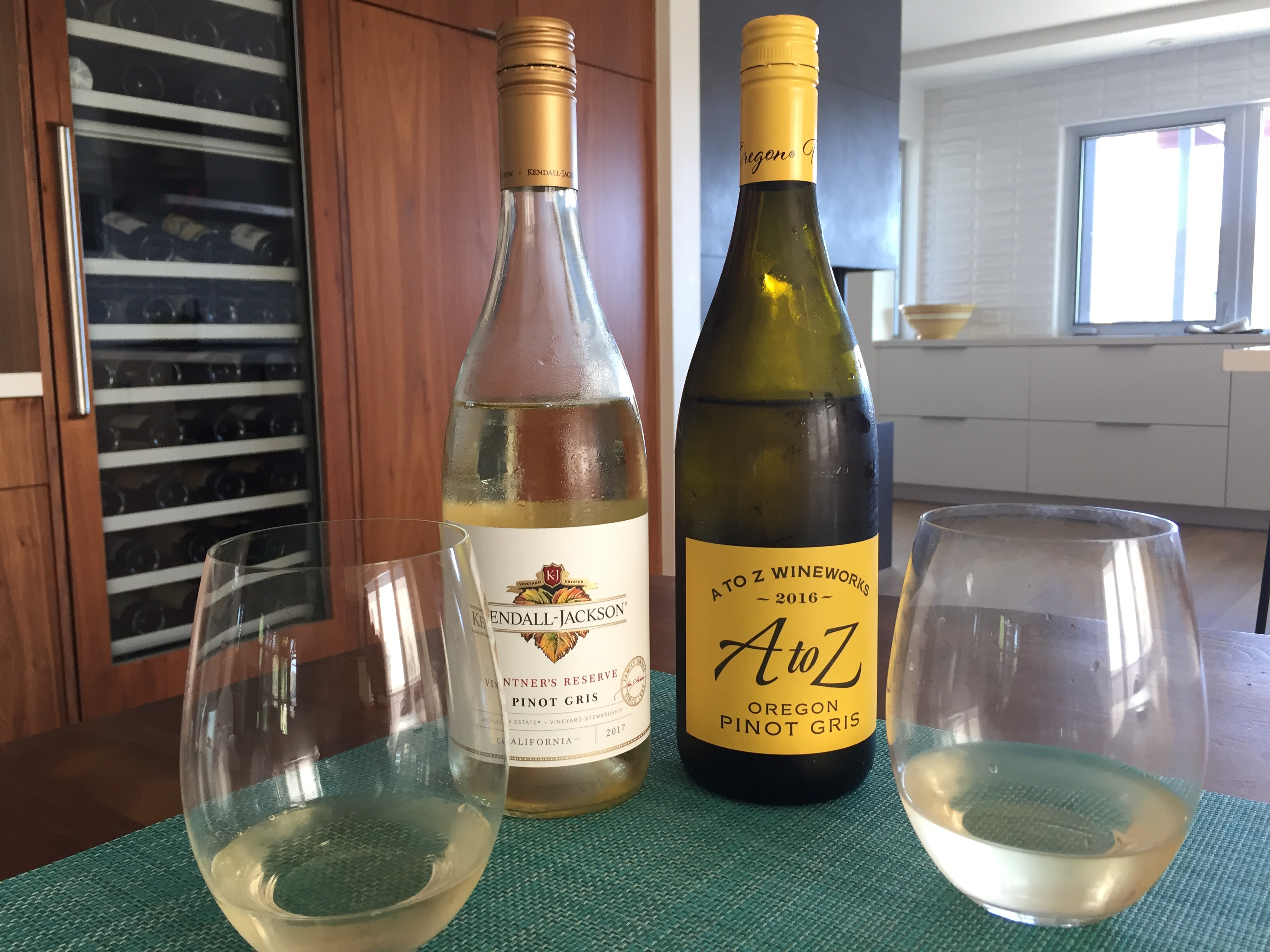 Bottle of 2017 Kendall Jackson Pinot Gris (left) and 2016 A to Z Wineworks Pinot Gris (right)