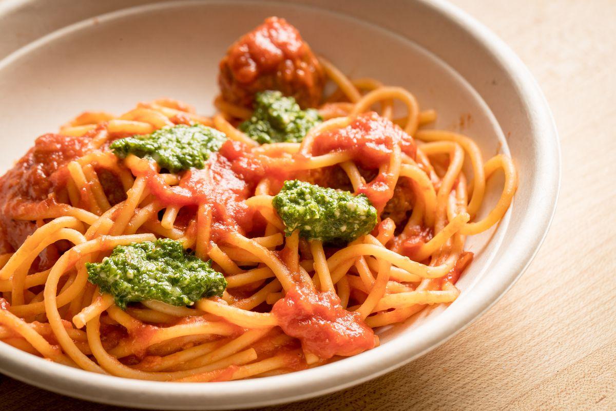 Bowl of pasta marinara and pesto.