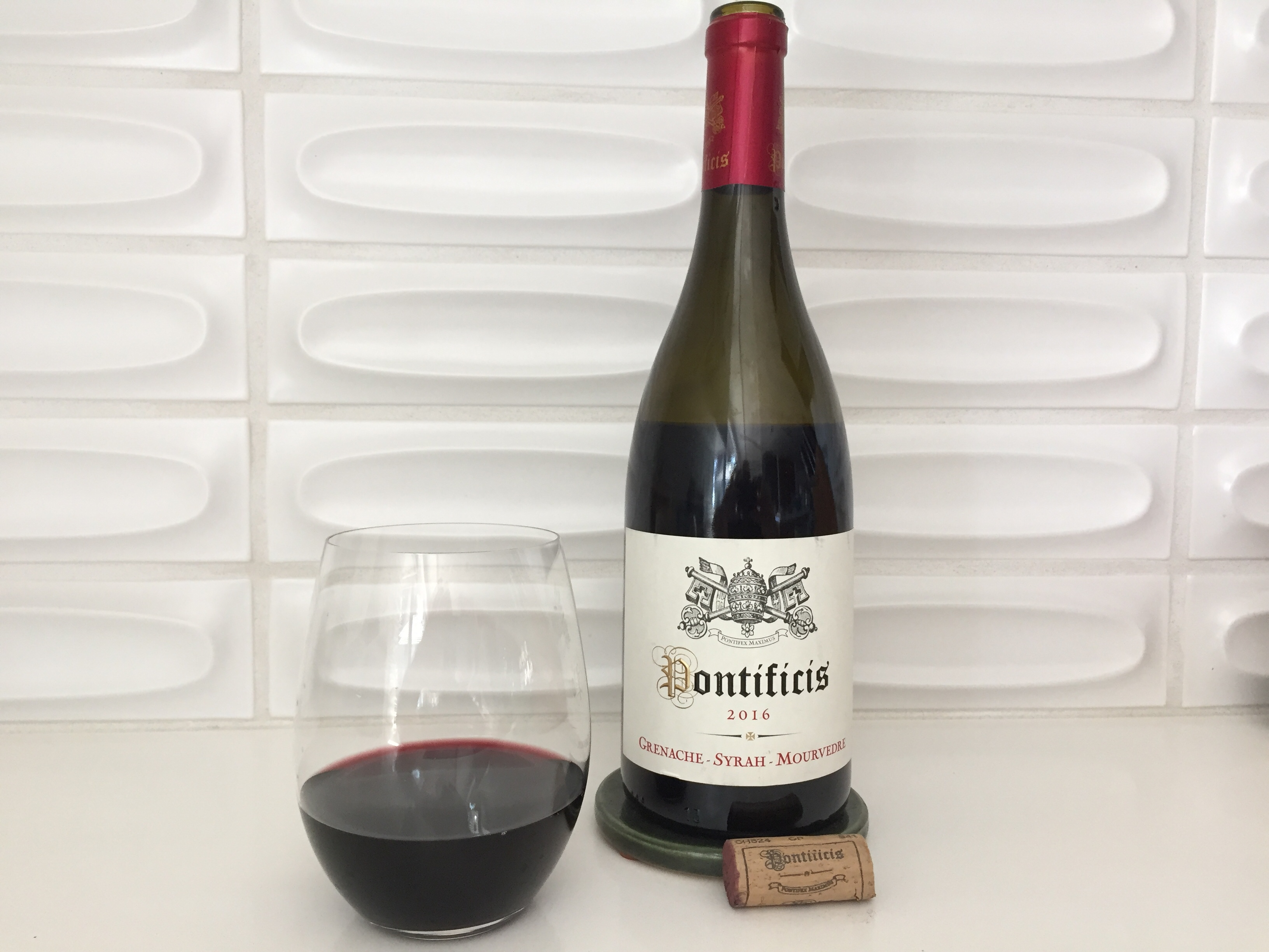Glass and bottle of Pontificis GSM from Trader Joe's