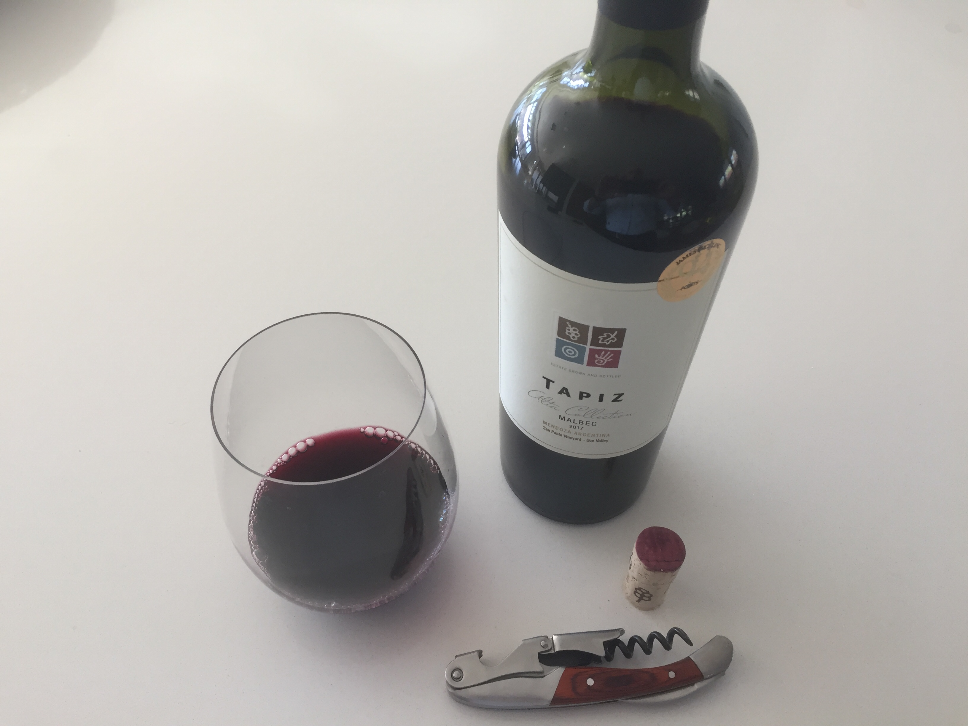 Photo of bottle and glass of Tapiz 2017 Malbec - $13.99 at Costco