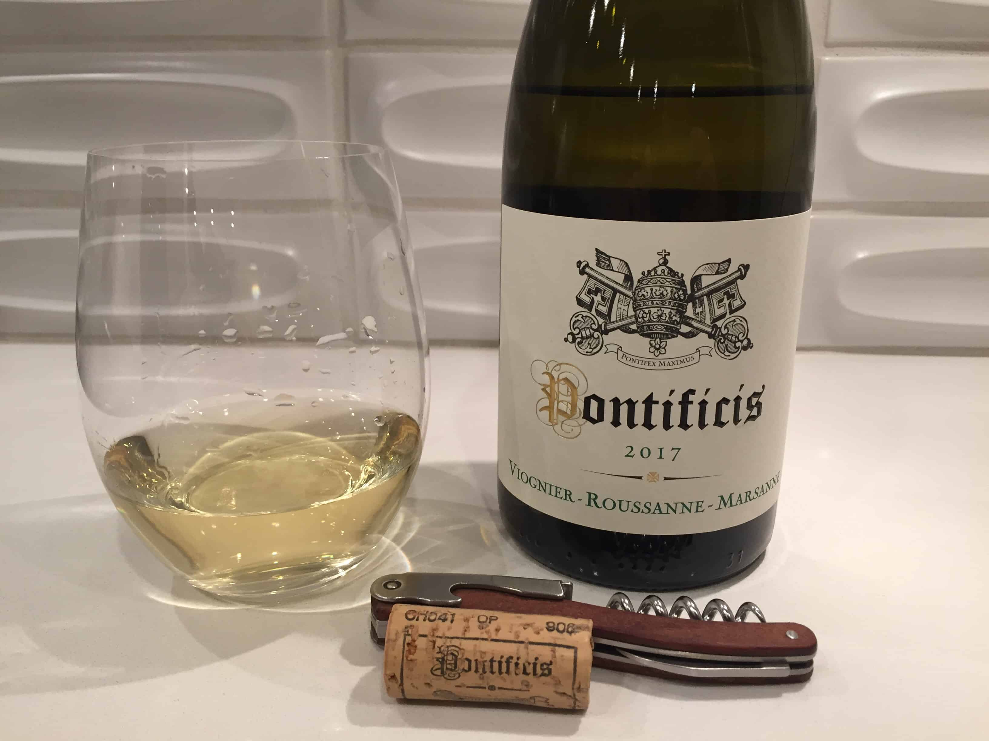 Glass and bottle of Pontificis White Rhone blend from Trader Joe's