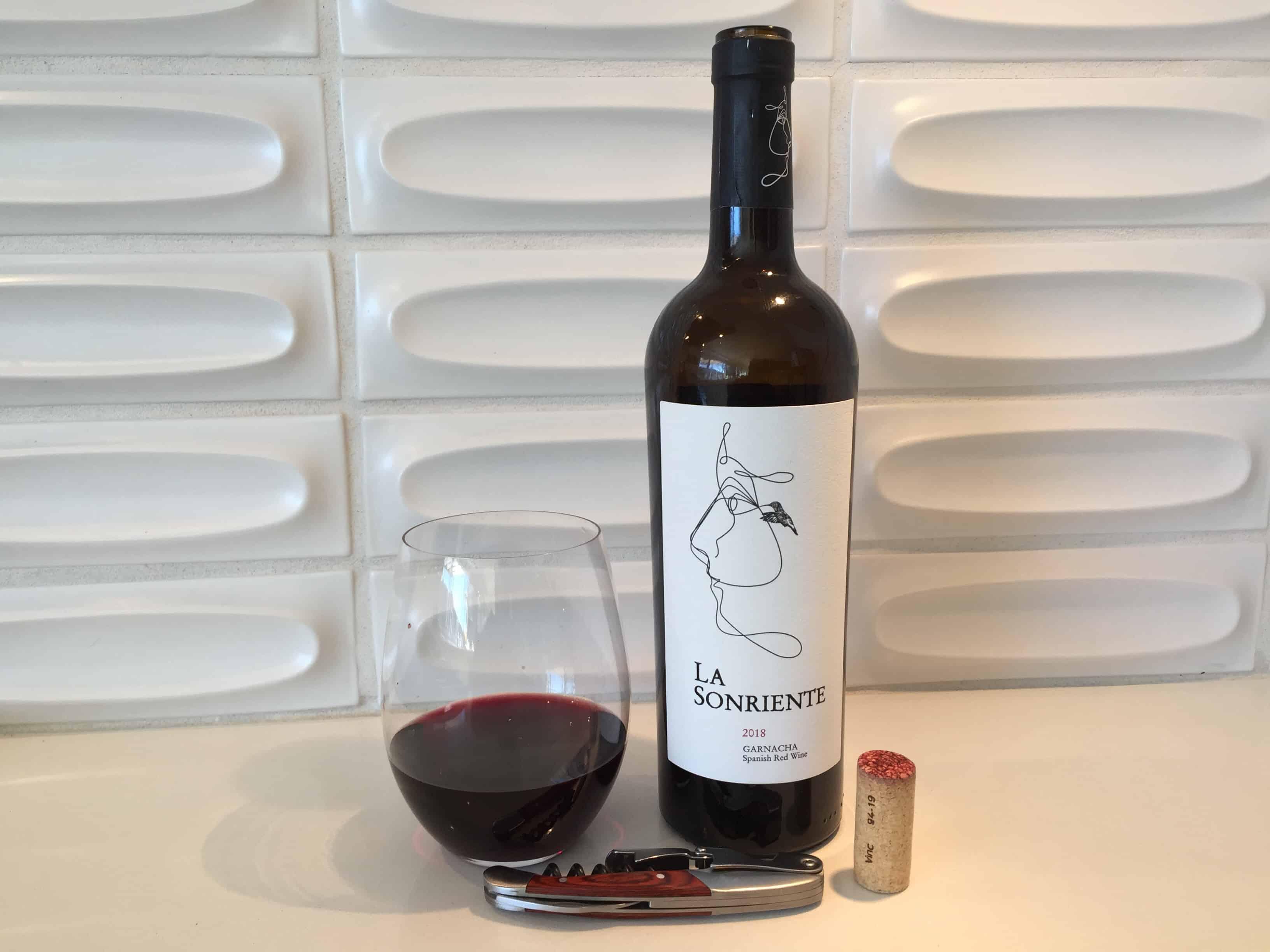 Glass and bottle of La Sonriente Garnacha Spanish red wine
