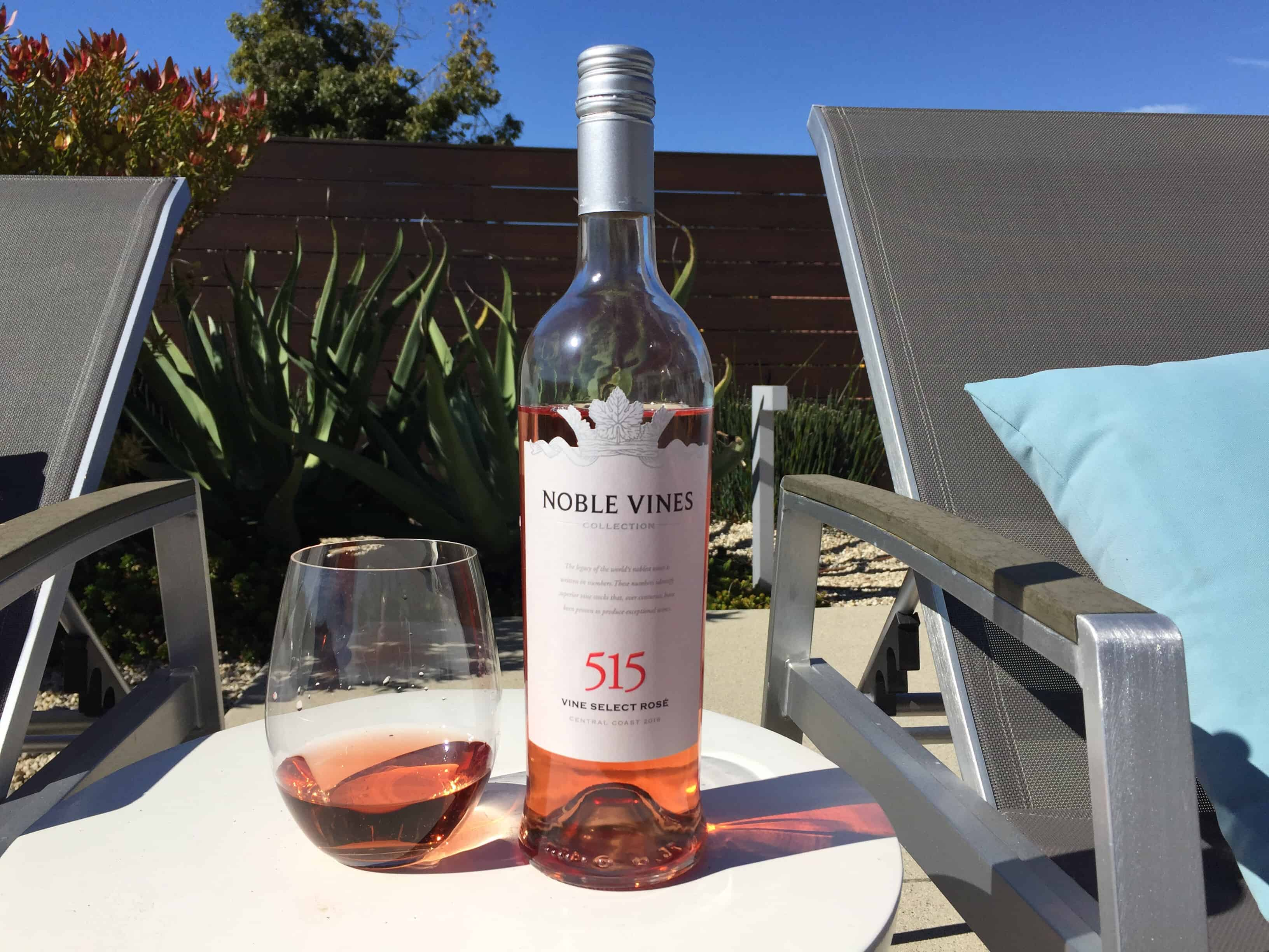 Glass and bottle of Noble Vines 515 Rose from Costco