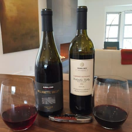 Bottles and glasses of Washington state Pinot Noir and Cabernet Sauvignon