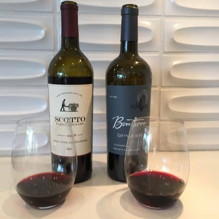 Bottles and glasses of Scotto Zinfandel and Bonterra red blend