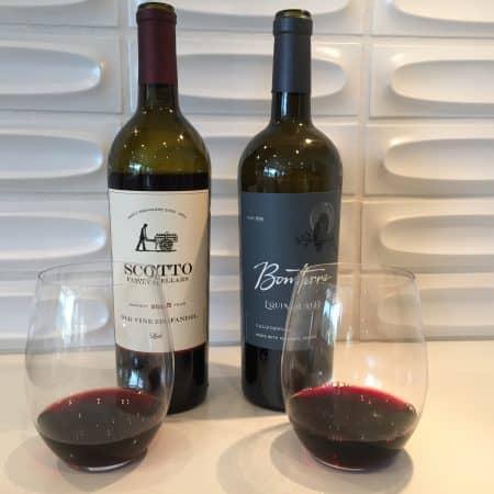 Bottles and glasses of Scotto Zinfandel and Bonterra red blend