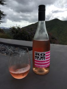 Glass and bottle of Charles and Charles 2018 Rose from Costco
