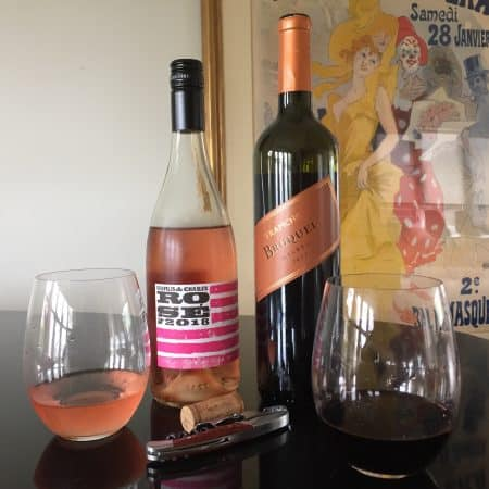 Glasses and bottles of this week's two featured wines