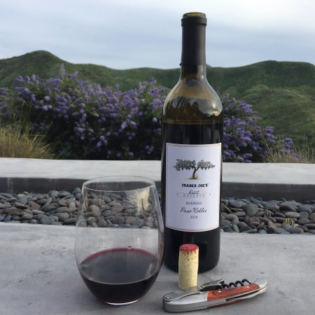 Bottle and glass of Trader Joe's Petit Reserve Barbera 2018