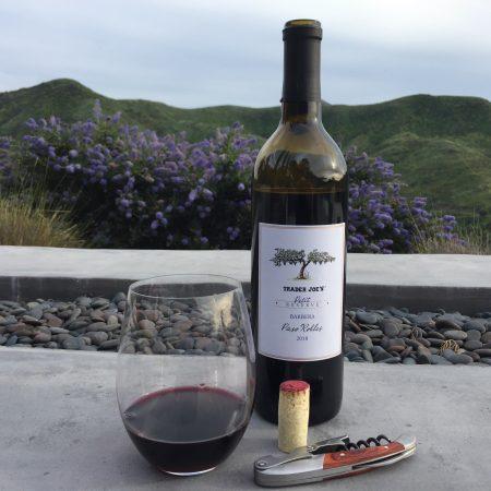 Bottle and glass of Trader Joe's Petit Reserve Barbera 2018