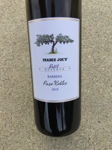 Close up photo of the front label of Trader Joe's Petit Reserve Barbera 2018 Paso Robles