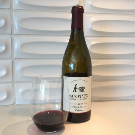 Bottle and glass of Scotto Family Cellars 2017 Pinot Noir from Trader Joe's