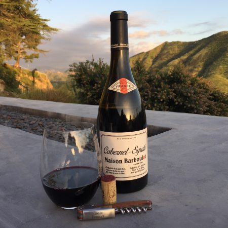Photo of glass and bottle of 2018 Maison Barboulot Cabernet Syrah from Trader Joe's
