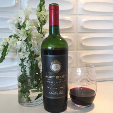 Bottle and glass of Secret Reserve 2018 Cabernet Sauvignon from Costco