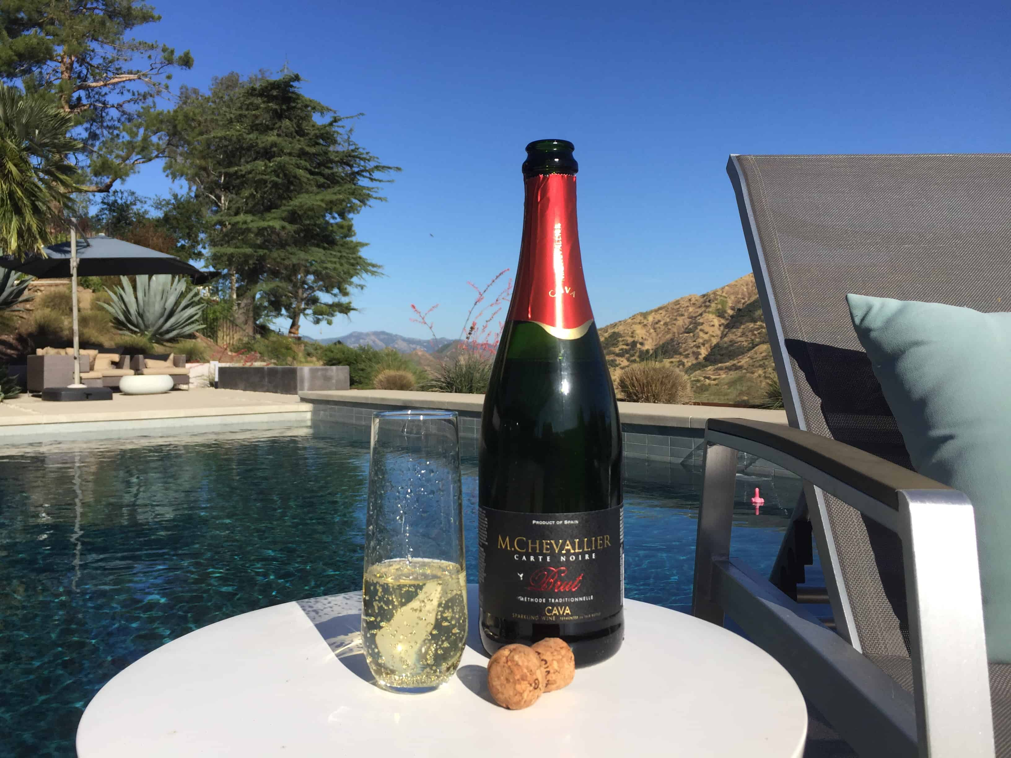 Bottle and glass of M. Chevallier Cava from Trader Joe's