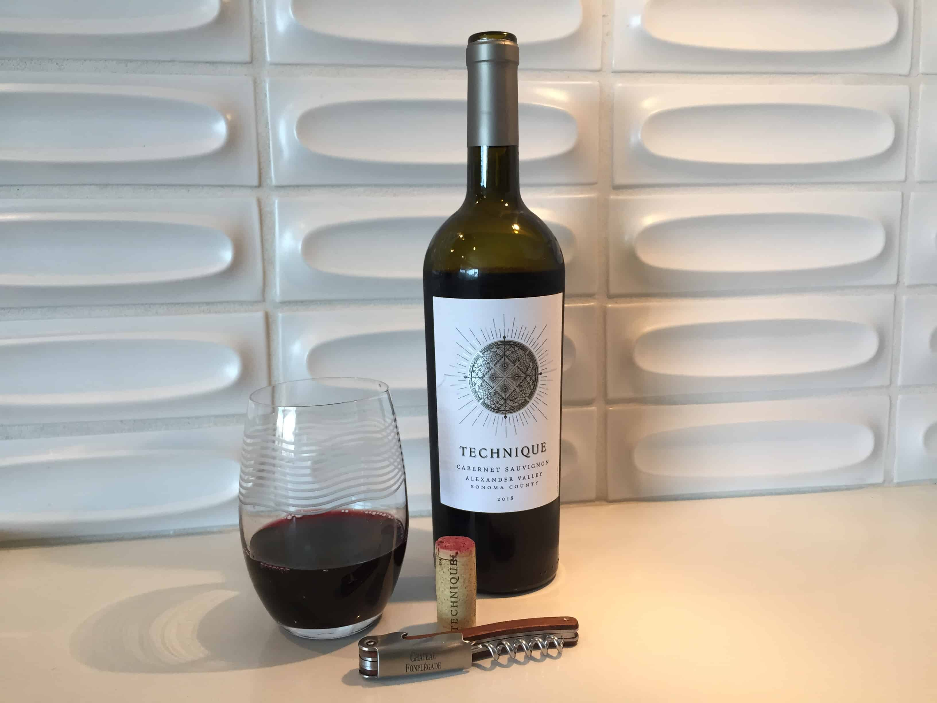 Bottle and glass of Technique 2018 Cabernet Sauvignon from Trader Joe's