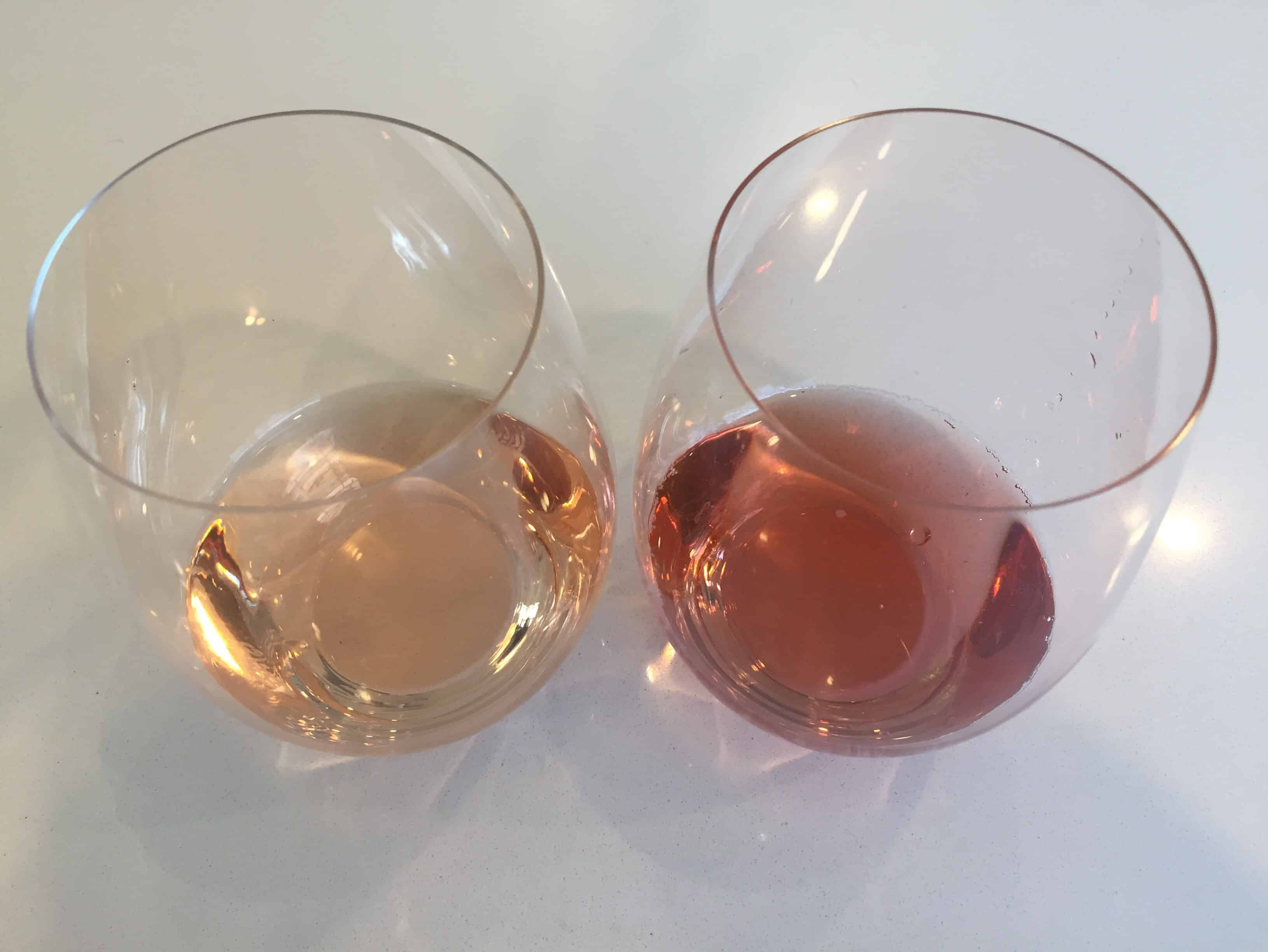 Two glasses of rose wine, contrasting the difference in color.