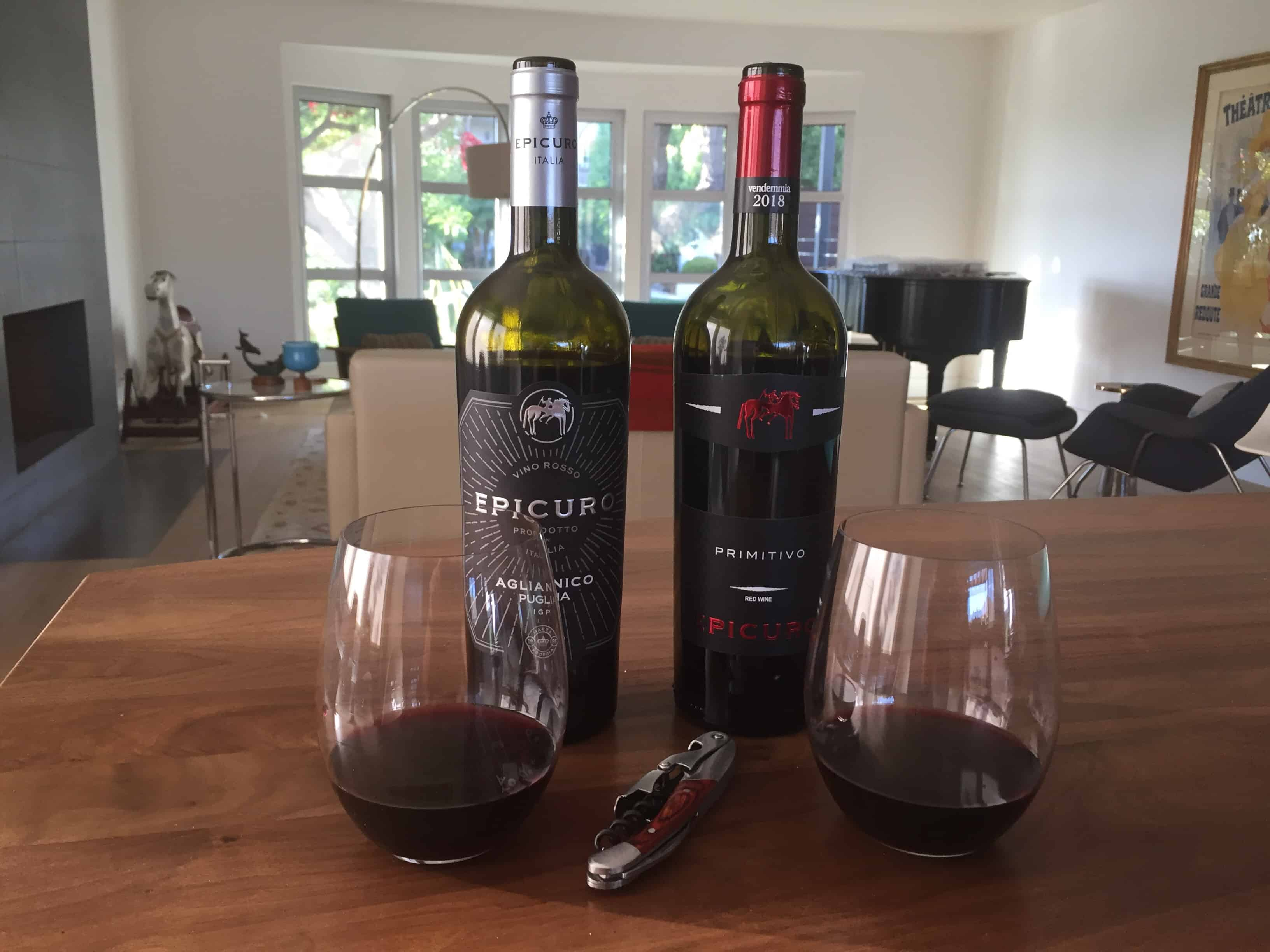 Bottle and glass of Epicuro Aglianico and Primitivo from Trader Joe's. Both pack a lot of fruity goodness for just $4.99.