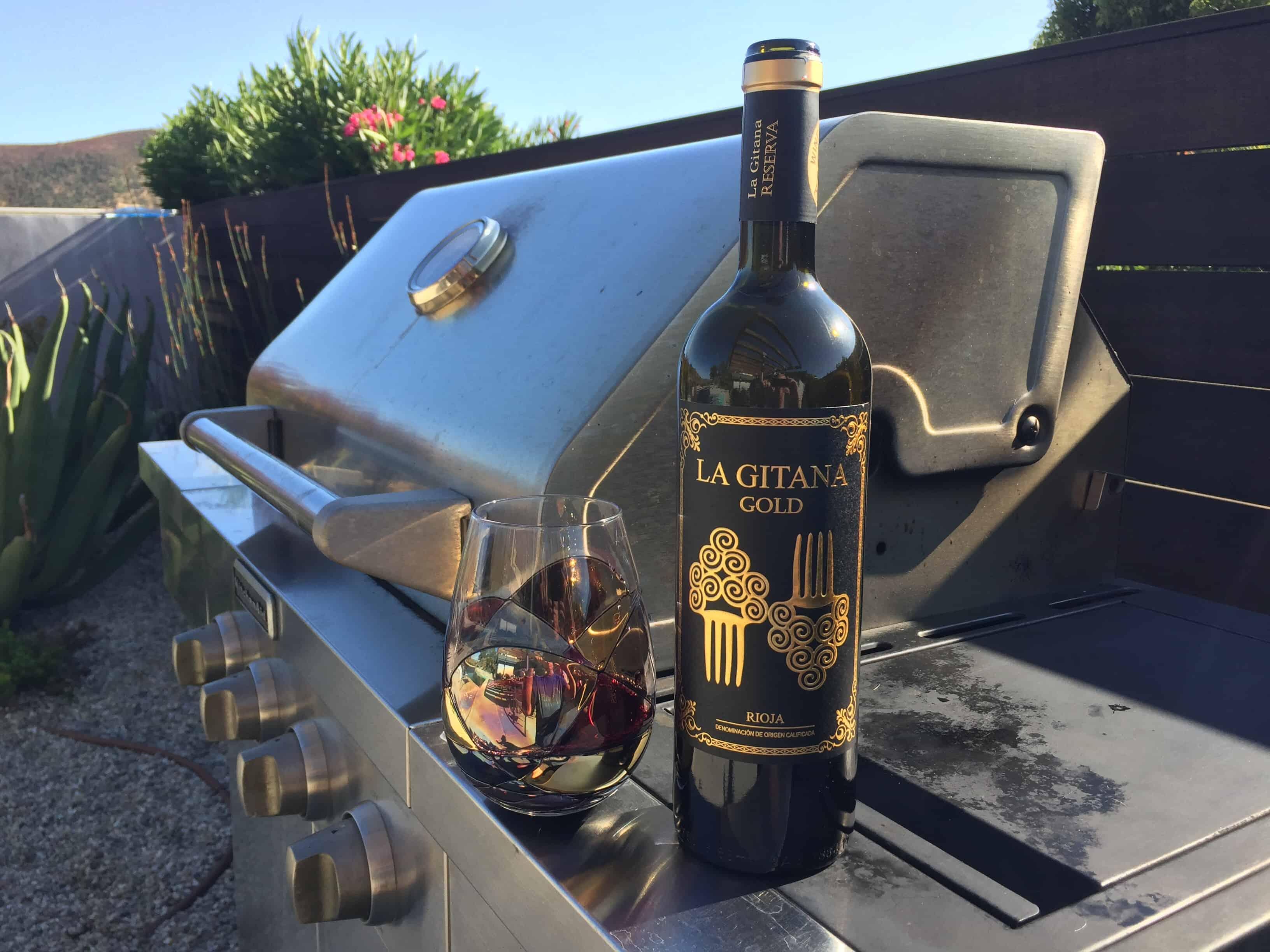Bottle and glass of La Gitana Gold 2015 Rioja Riserva from Costco