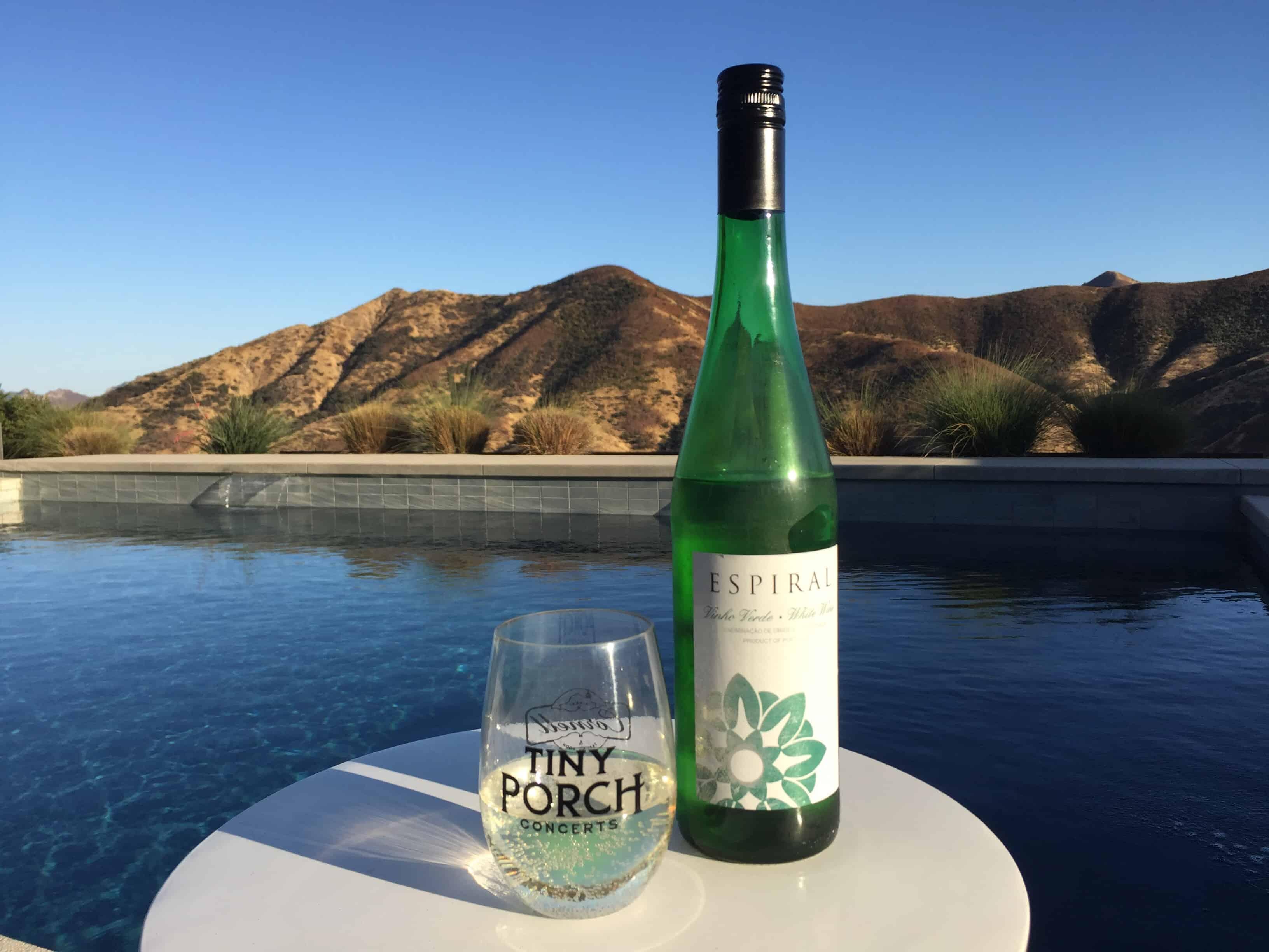 Glass and bottle of Espiral Vinho Verde from Trader Joe's