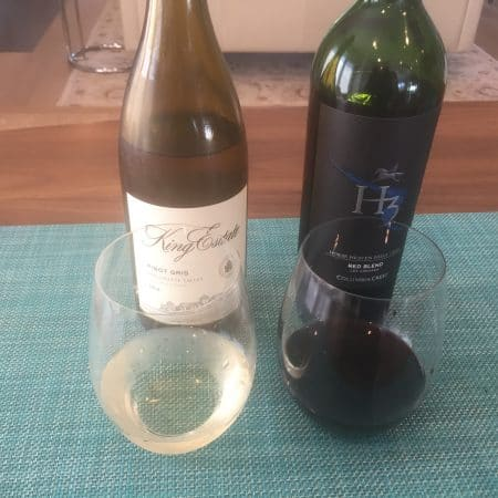 Bottle and glass of King Estate Pinot Gris 2018 and Columbia Crest 2016b Red Blend, both from Costco