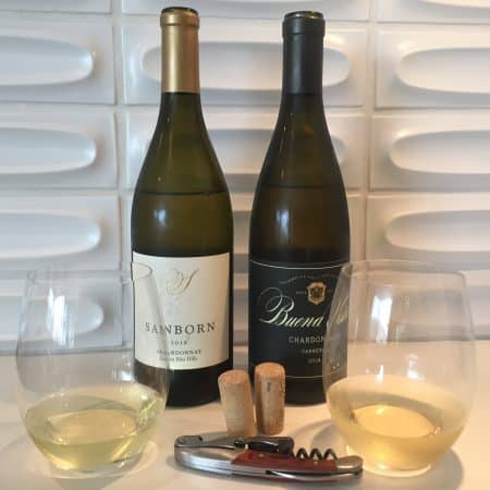 Bottles and glasses of Sanborn and Buena Vista Chardonnays from Traders Joe's