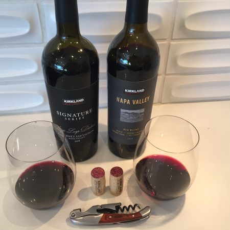 Bottles and glasses of Napa Valley red wines from Costco