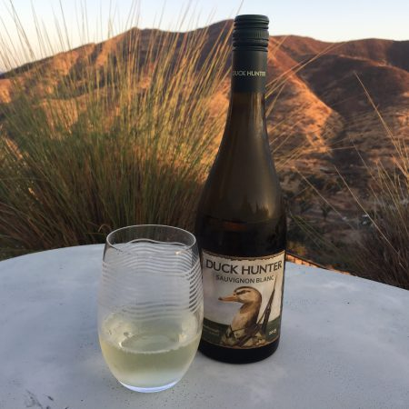 Bottle and glass of Duck Hunter 2019 Sauvignon Blanc from Costco