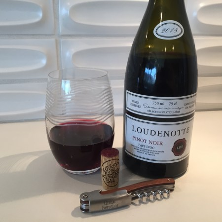 Bottle and glass of 2018 Loudenotte Pinot Noir from Trader Joe's