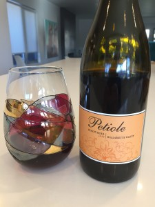 Glass and bottle of 2019 Petiole Pinot Noir from Trader Joe's