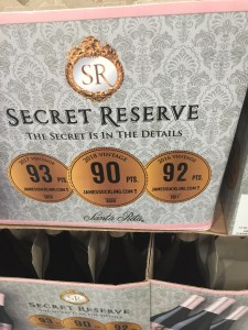 Photo of Secret Reserve 2018 Pinot Noir case-stacked at Costco and showing 90+ point scores for 2016, 2017 and 2018 vintages.