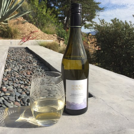 Glass and bottle of the Nikau Point 2020 Sauvignon Blanc from Trader Joe's