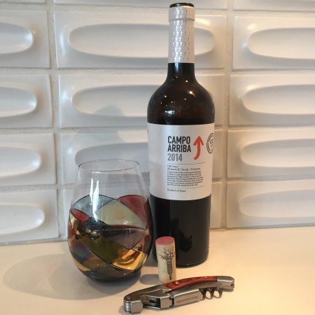 Glass and bottle of Campo Arriba 2014 red wine from Costco
