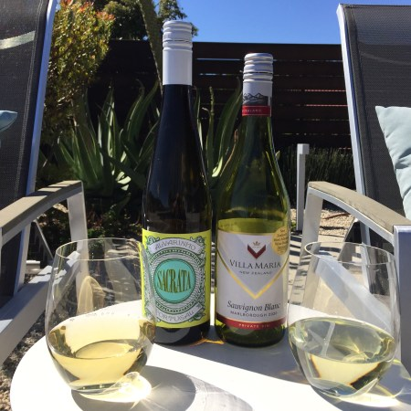 Bottles and glasses of 2019 Sacrata Alvarinho and 2020 Villa Maria Sauvignon Blanc, both from Costco