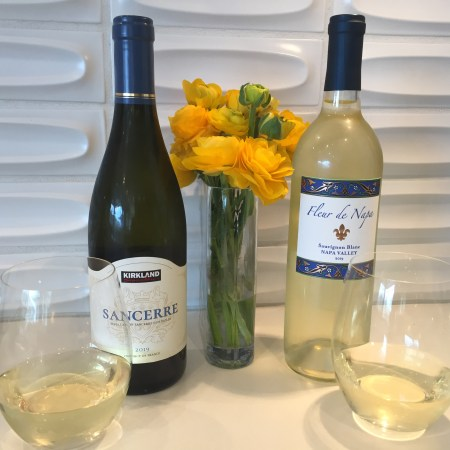 Bottles and glasses of Kirkland Signature 2019 Sancerre (left) from Costco and Fleur de Napa 2019 Sauvignon Blanc from Trader Joe's