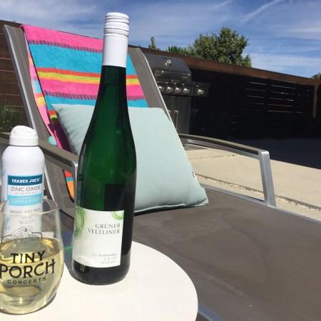 Glass and bottle of Floriana 2019 Gruner Veltliner from Trader Joe's. Also, Trader Joe's SPF sunscreen.