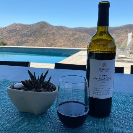 Bottle and glass of Trader Joe's Reserve 2020 Dry Creek Valley Sonoma County Zinfandel