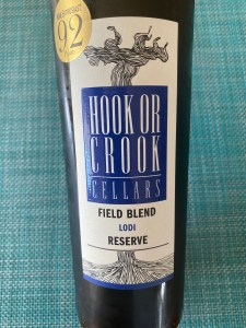 Front label of 2018 Hook or Crook Red Field Blend 92 points for $5.79 (after $5 promotional discount) from Costco.