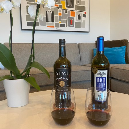 Bottles and glasses of 2018 Simi Winery red wine blend and Hook or Crook Cellars 2018 red field blend from Costco.
