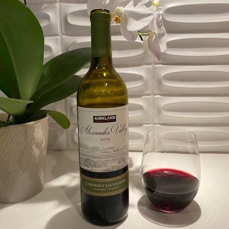 Bottle and glass of Kirkland Signature 2018 Alexander Valley Cabernet Sauvignon.