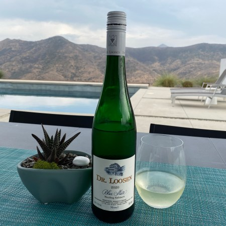 Bottle and glass of Dr. Loosen 2020 Blue Slate Riesling Kabinett from Costco
