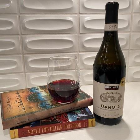 Kirkland Signature 2016 Barolo alongside and atop Italian cookbooks.